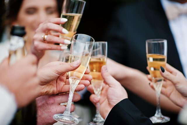 people toasting with glasses of champagne