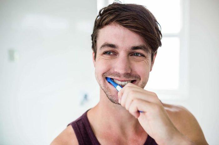 man smiling and Brushing teeth