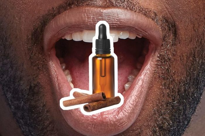 Cinnamon oil over an open mouth