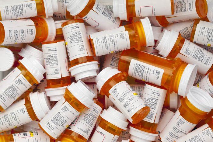 Dozens of prescription medicine bottles in a jumble