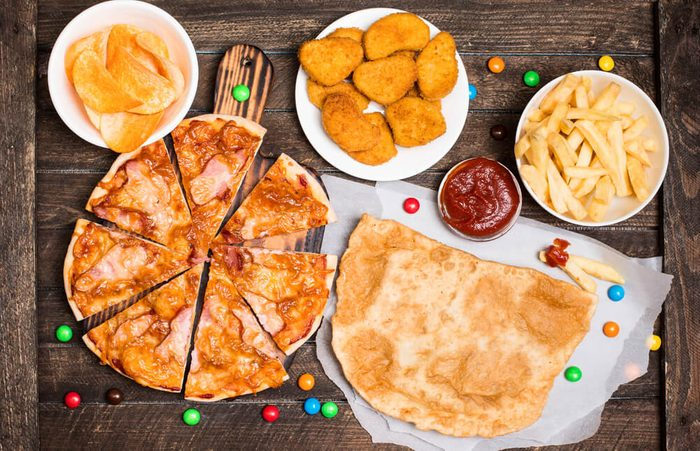 Fast food or junk food background top view.