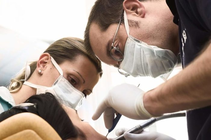 dentist and assistant working on a sedated patient