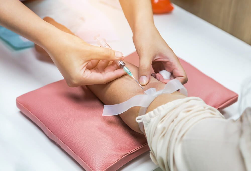 person having blood sample drawn