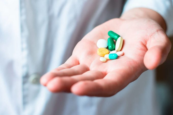 A handful of pills and capsules.