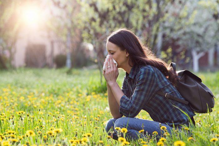 woman allergies tissue outdoors grass