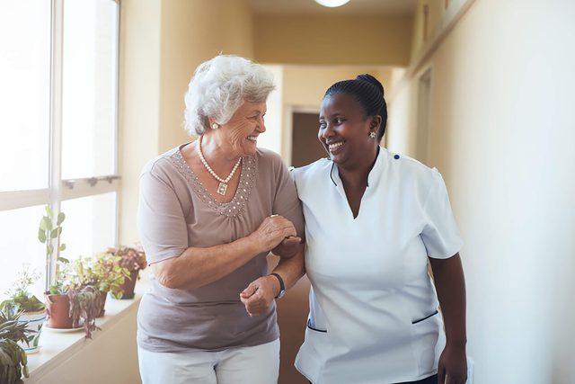 patient advocate walking with patient