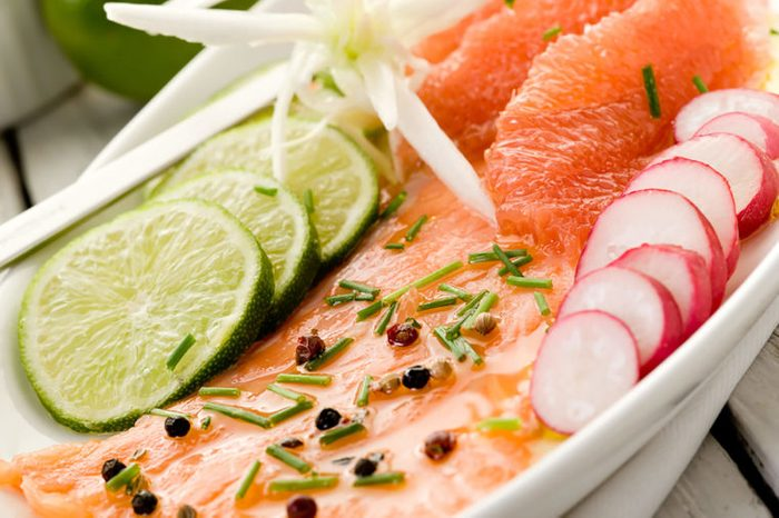 Salmon with grapefruit slices.