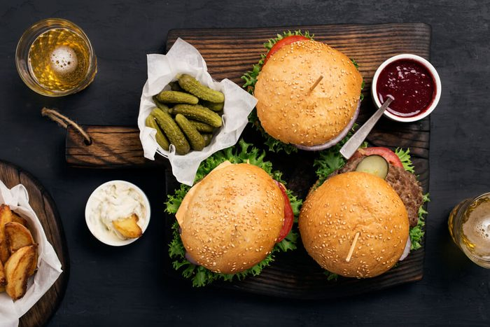 hamburgers, pickles, fries, and condiments
