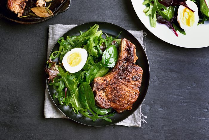 Roasted steak with green salad and egg