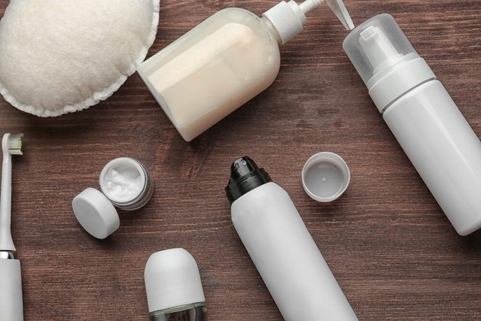 Set for personal care with deodorants on wooden table