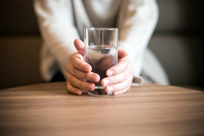 Woman holding a glass of the water