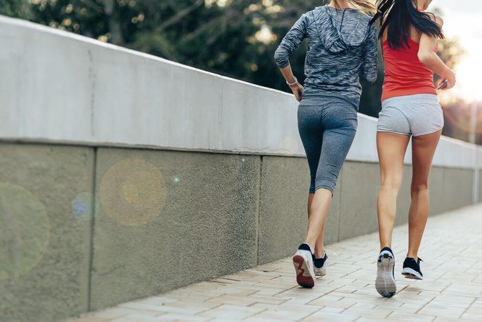 Women jogging in city in dusk
