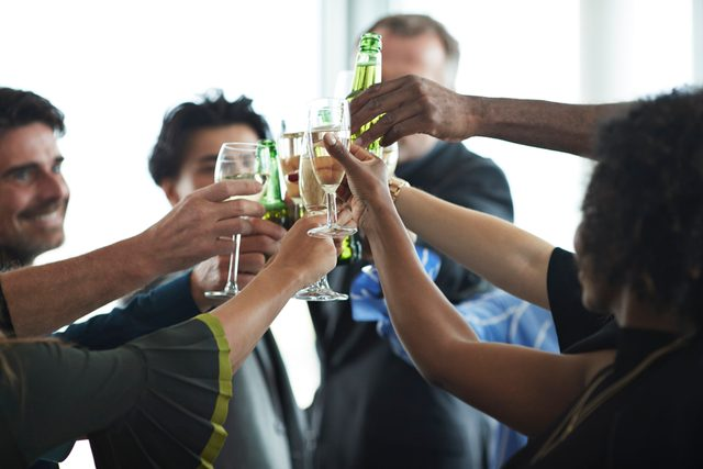 group of people drinking at an event