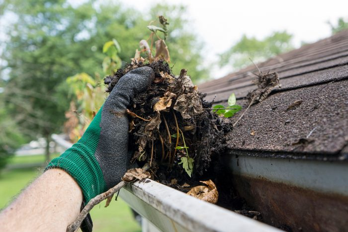 cleaning out gutters of house