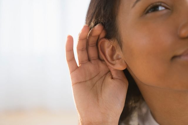 woman cupping her ear