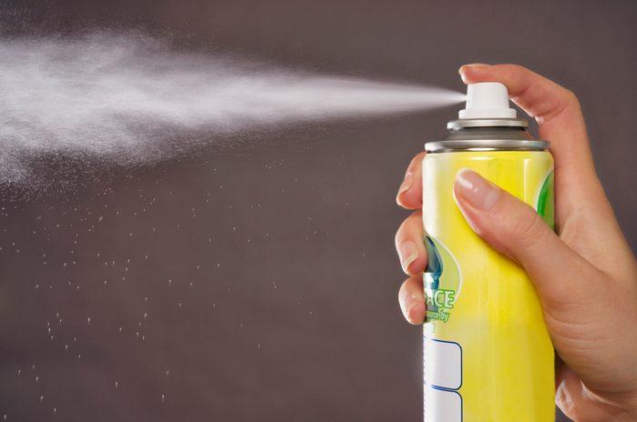 close up of aerosol can spraying