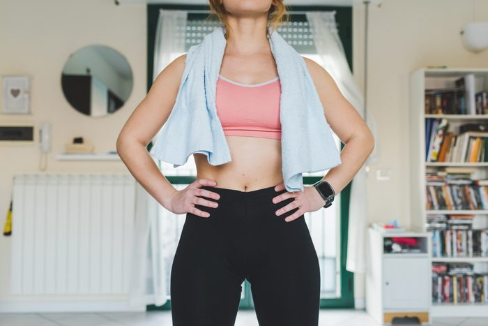 mid section of young woman after work out