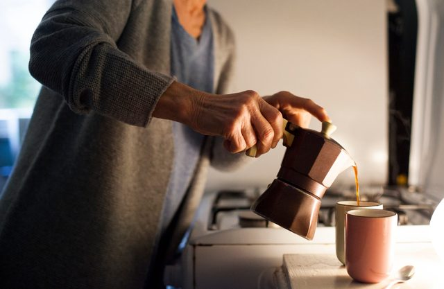 woman pouring her morning coffee