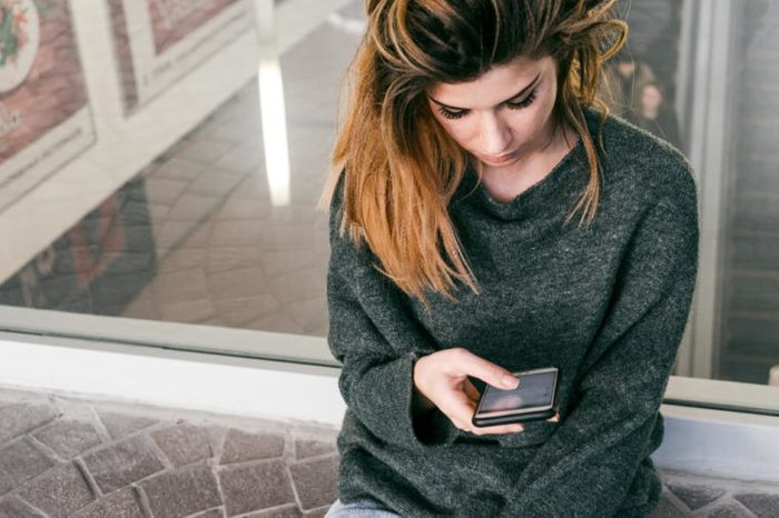 Texting woman close-up.