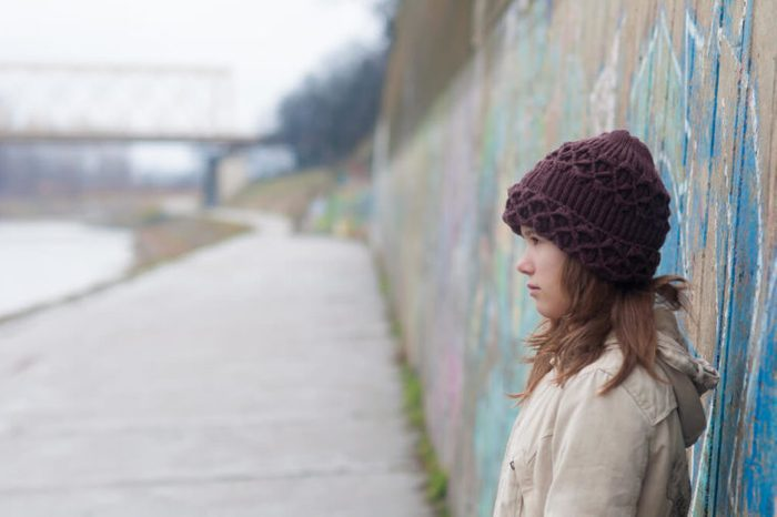Lonely girl in urban environment.