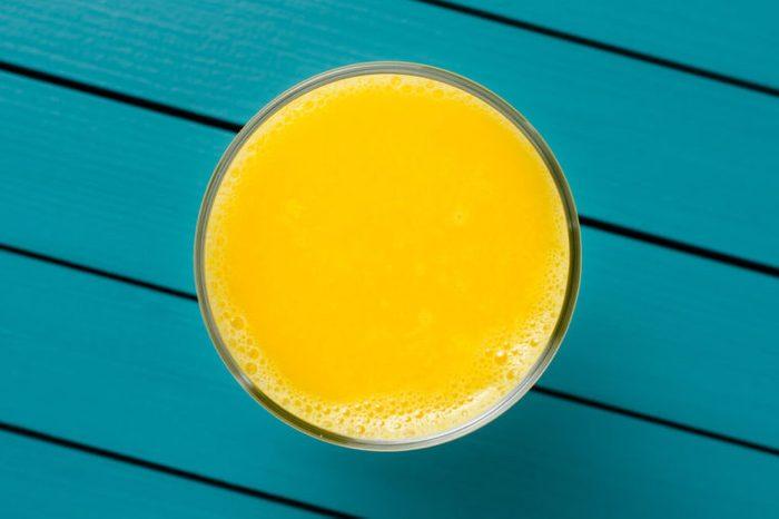 Fresh orange juice on wooden table