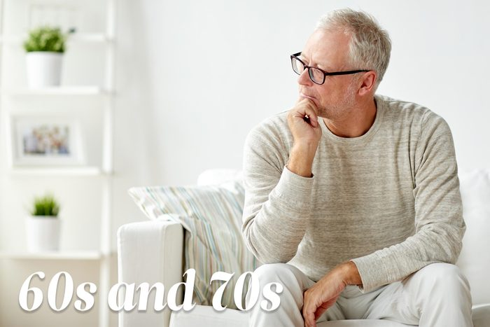mature man sitting on couch