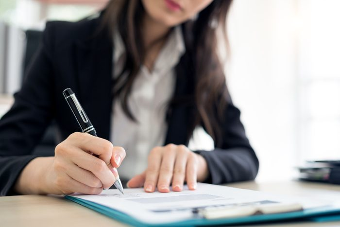 businesswoman signing a contract close up