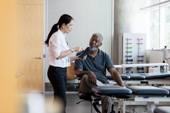 physical therapist talking with patient