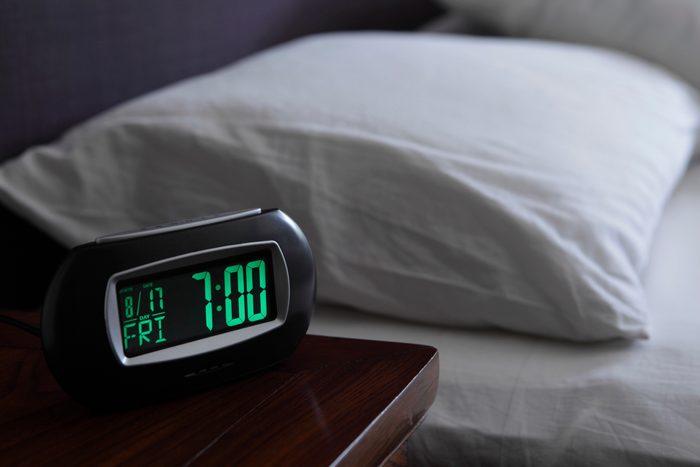 alarm clock on night stand