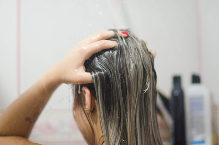 woman washing hair in the shower