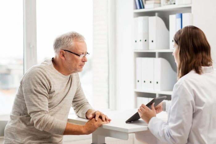 man patient speaking with a woman doctor