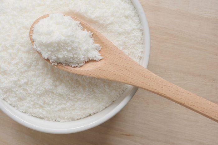 Collagen powder on a wooden spoon