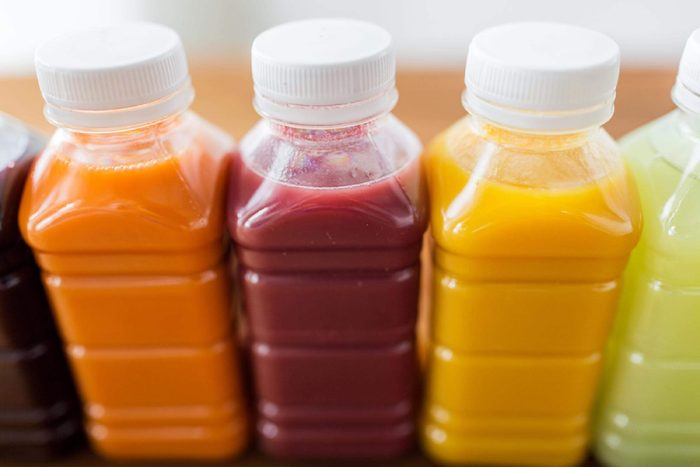 Bottles of colorful fruit and vegetable juices.
