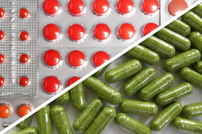 red iron capsules next to green capsules