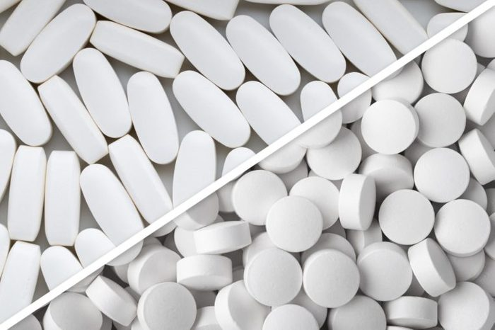 white oblong pills next to white round pills