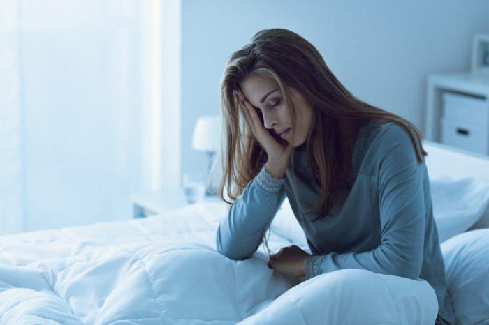 sleeplessness woman bed tired sad
