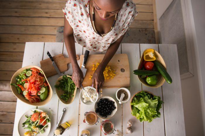 woman preparing healthy food, vegetables