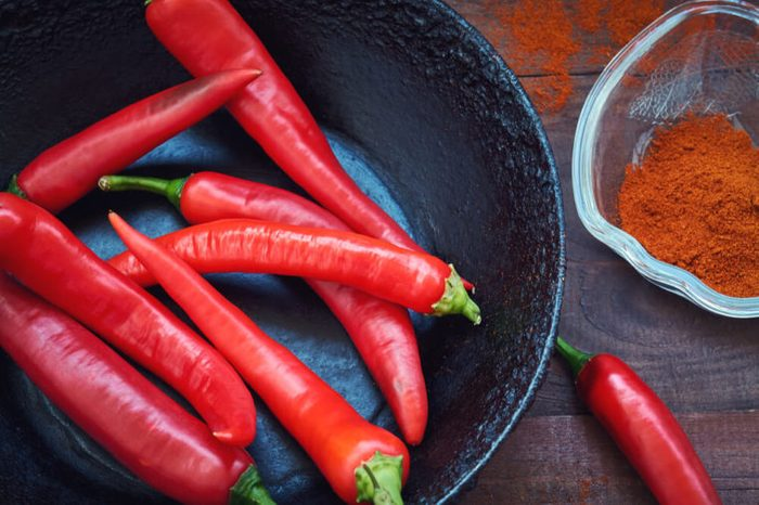 Raw red pepper in a frying pan