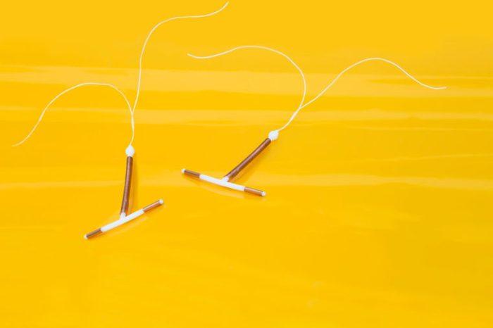 IUD birth control on a yellow table