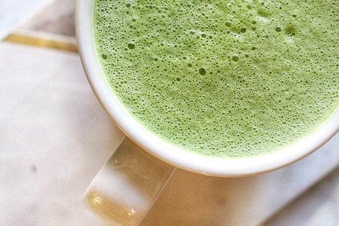 green matcha drink in white coffee cup