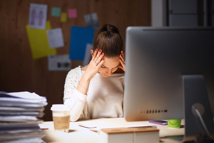 tired woman sitting at computer