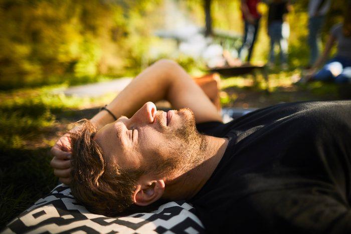 man laying down soaking up the sunshine