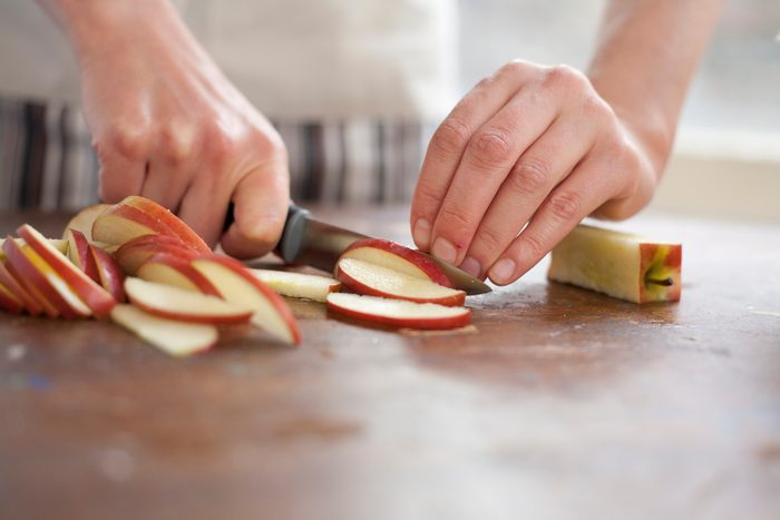 close up of woman slicing apples