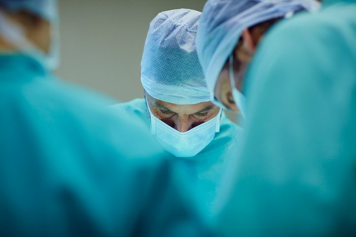 surgeons working in operating room in hospital