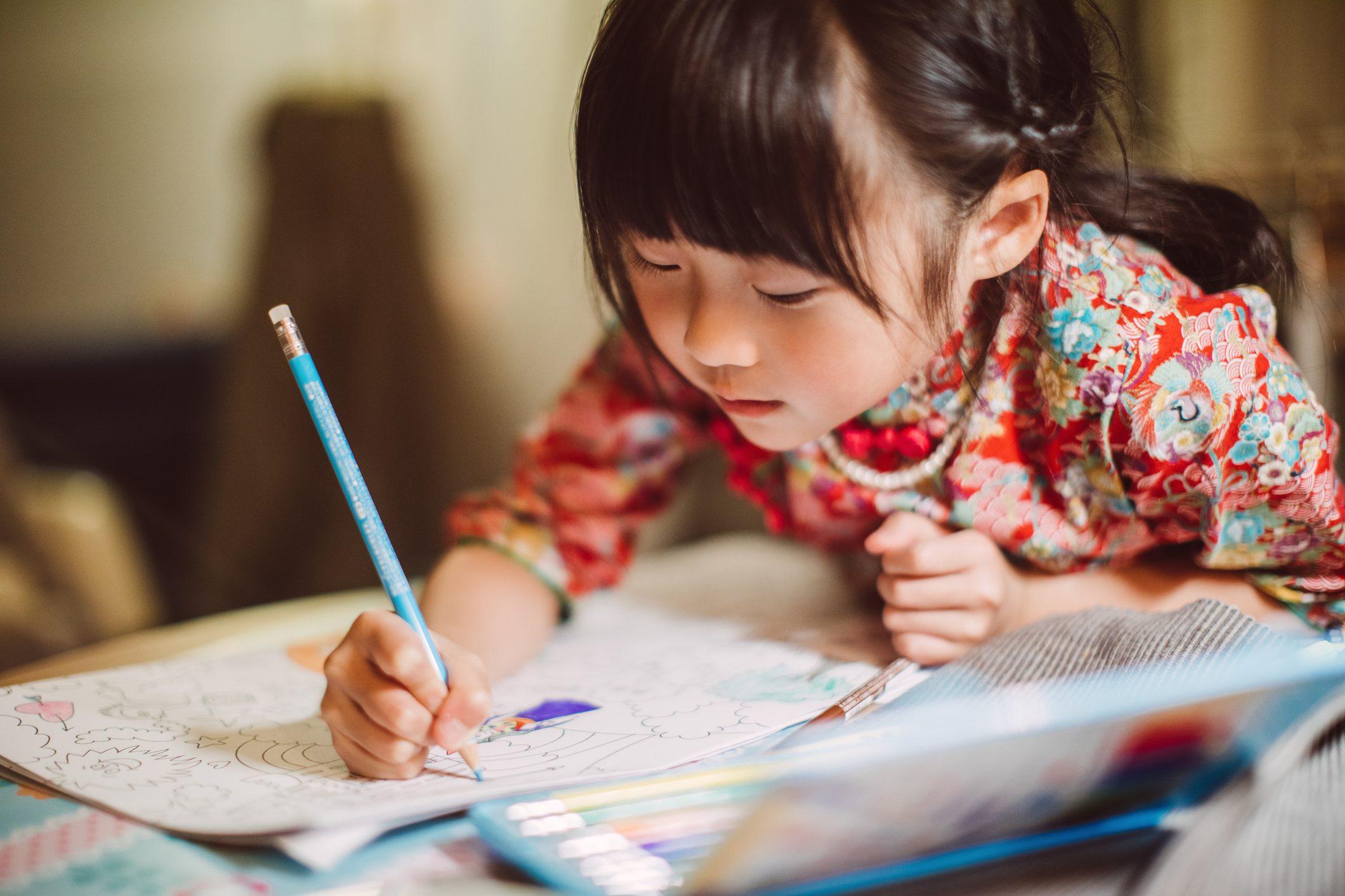 little girl drawing artwork