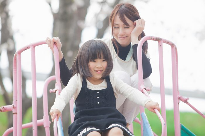 mom and child playing on playground