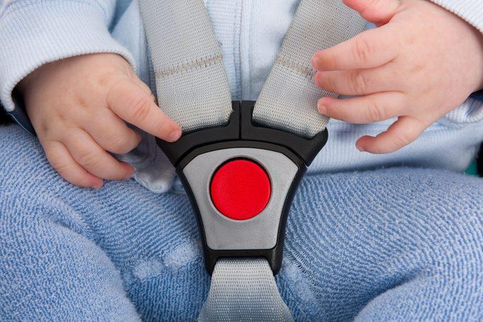 closeup of baby car seat belt