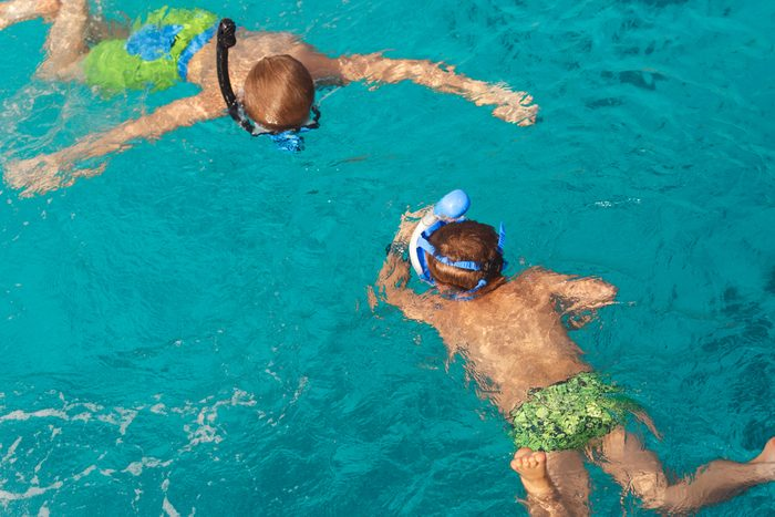 kids swimming with snorkeling gear