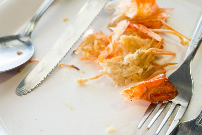plate of scraps after eating shrimp