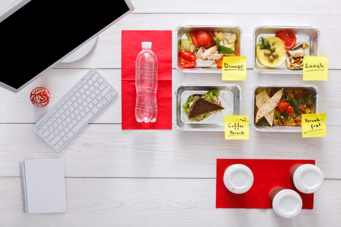 Vegetables, meat and fruits in foil boxes with meal labels